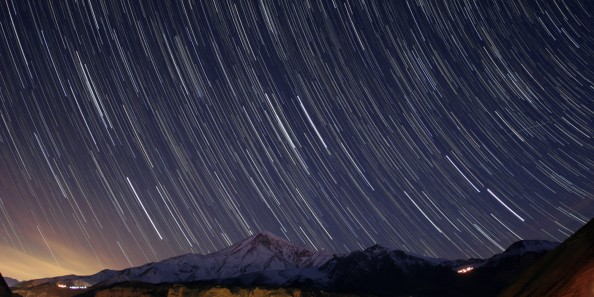 IRAN - SEPTEMBER 07: Star trails, a Quadrantid meteor, the trail of the Hubble Space Telescope, all above Mount Damavand in Alborz range of Iran on the early morning of 2009 January 4. (Photo by Babek Tafreshi/SSPL/Getty Images)
